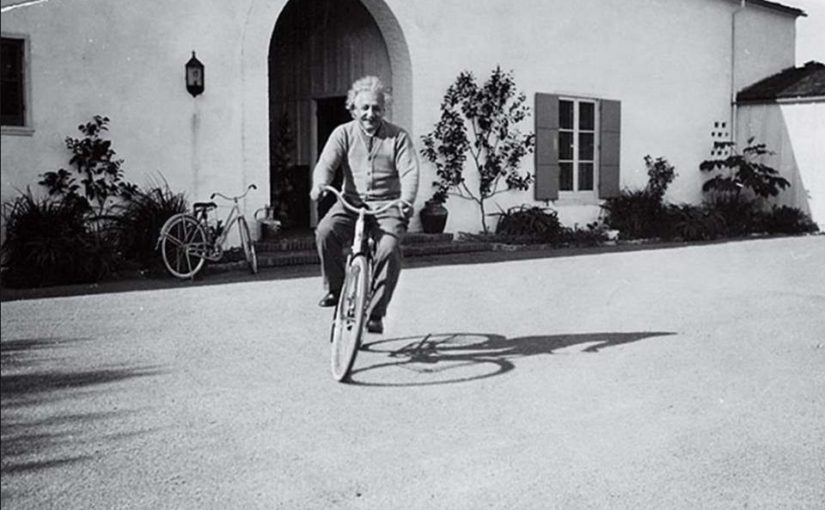 Albert Einstein, riding a bike