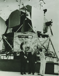Tullio Campagnolo in front of NASA satellite OSO 6.
