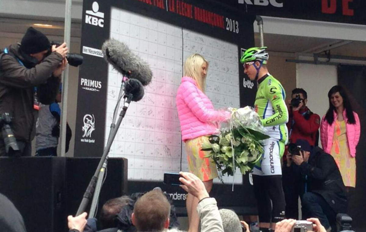 Peter Sagan gives flowers to Maya Leye