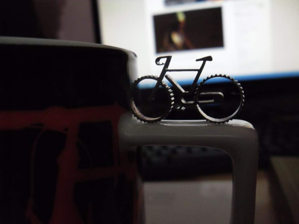 A micro bicycle and a mug