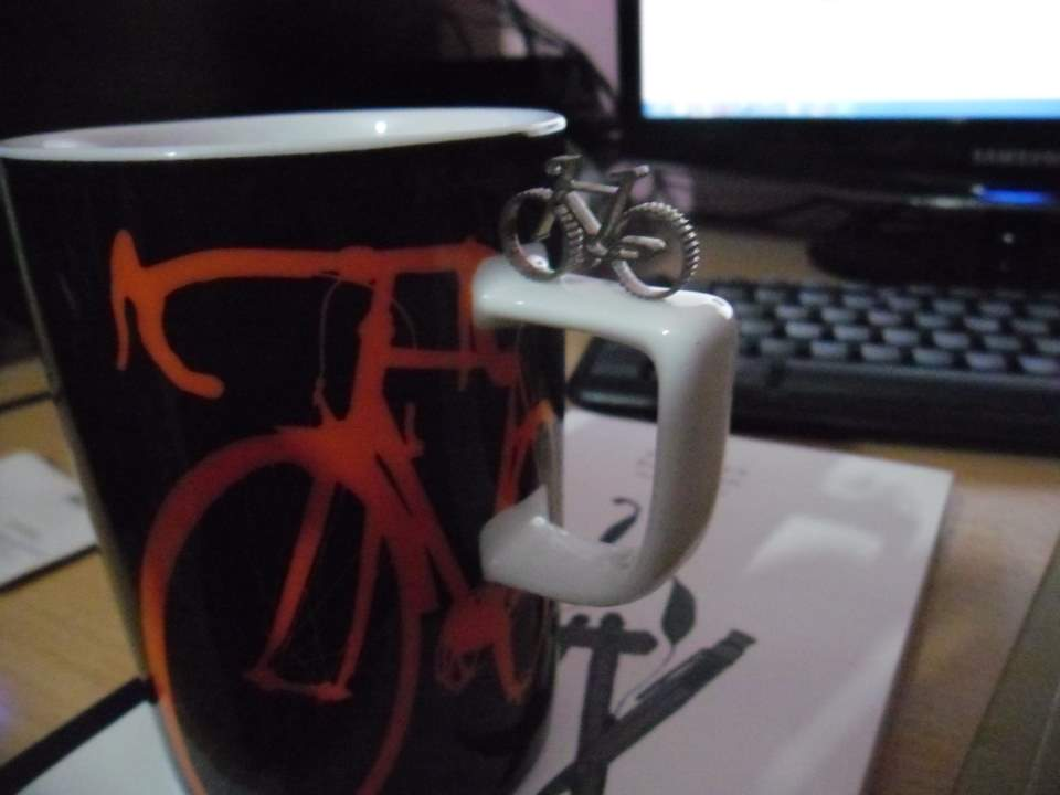 A micro bicycle and a mug with a bicycle image