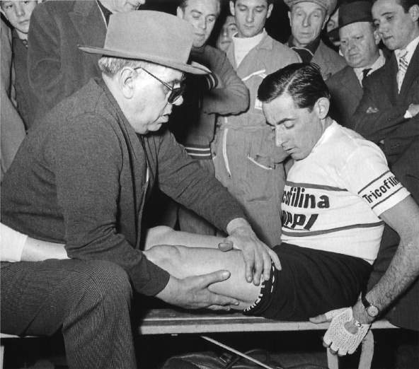 Fausto Coppi gets the treatment from his blind soigneur, Biagio Cavanna