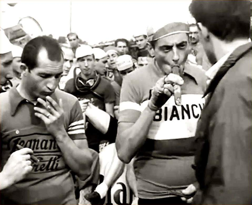 Fausto Coppi and Gino Bartali smoking cigars
