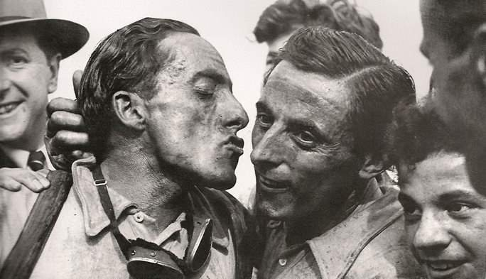 Serse Coppi kisses Fausto Coppi after Paris Roubaix 1949