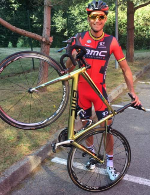 Greg Van Avermaet shows his golden painted BMC bike
