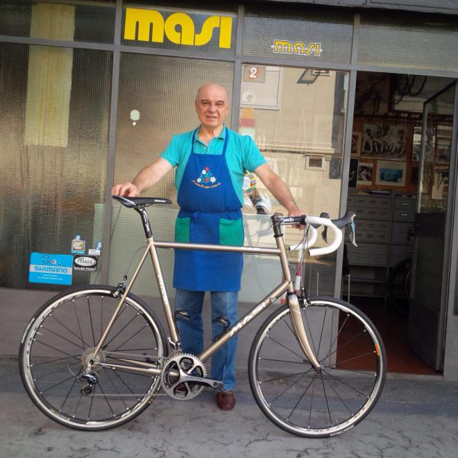 Alberto Masi in front of his bike shop in Milano