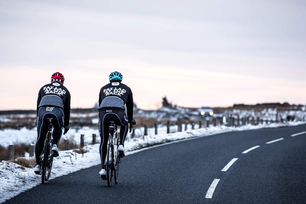 Two cyclists in winter