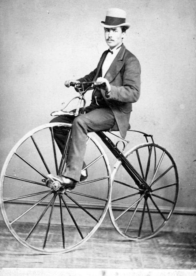 Riding and balancing a bicycle - Man on a velocipede