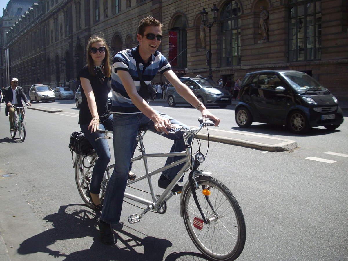 A Couple on a tandem bicycle in Paris