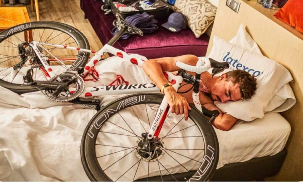 Julian Alaphilippe sleeps with bicycle